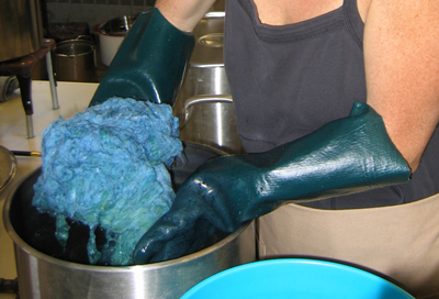Demonstration of dyeing wool fiber with indigo revealing the color change from a green to blue when exposed to the air (Felt Dimension Concentration, Penland School of Crafts workshop, 2006)