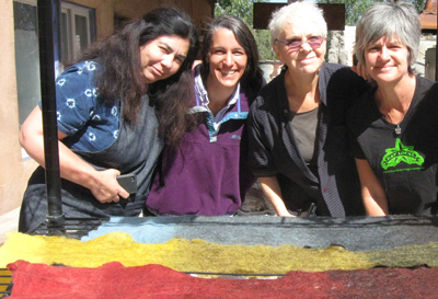 Partial felt sheets dyed with cochineal, weld and indigo (participants in Taos Wool Festival workshop, Taos, NM, 2011)