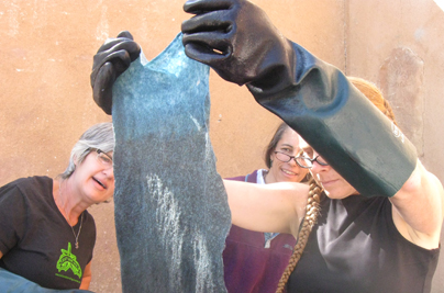 Indigo dyeing over a gradation of colored animal fibers (Lisa Klakulak with participants, workshop at Taos Wool Festival, 2011)