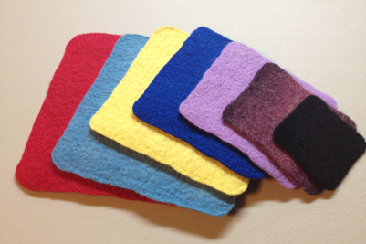 STRONGFELT samples of various weights of fiber layout for calculating percentages of shrinkage and shrinkage factors so to be able to achieve desired results such as drape for wearables, wall thickness for hollow forms, dimension of surface design when applying partial felts, etc