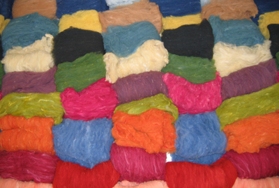 Carded, Naturally dyed washed locks of wool fiber (Felt Dimension Concentration, Penland School of Crafts, 2006)