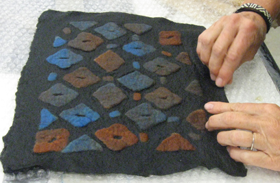 Partial felt patterning created from a color gradation (participant of workshop in conjunction with Textiles Today Exhibit at the Durango Art Center, CO 2012)