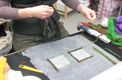 Applying strips of high integrity partial felt to the edge of fabrics to seal the cut edge, a technique used in creating stained glass effect with fabric (Annelie Richardsson's work, Ullform, Stavanger, Norway workshop, 2012)