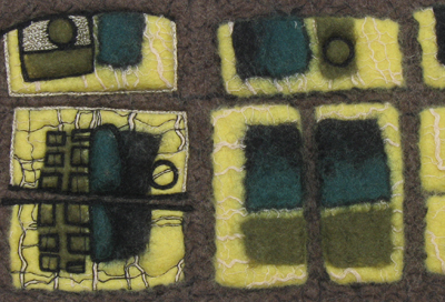 STRONGFELT sample of a multiple tiered partial felt surface design detailed with free-motion embroidered embossing