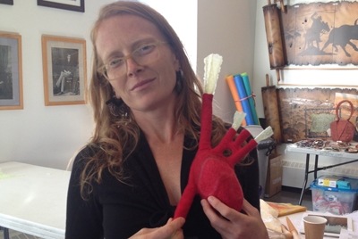 Excited by her comprehension of the techniques, I hold Sandy Compton's heart, her second hollow form during the course (Galt Museum, Lethbridge, Alberta, Canada workshop, 2014)