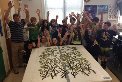 The third group arranged their leaves from the smallest and brightest yellow/green to the largest dark green responding to the design layout of the prior classes...fingers spread like branches and high 5's for the 5th grade!!