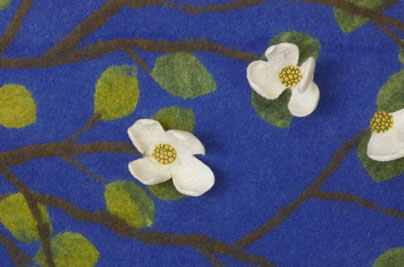 Of course, I had to add a few punches of free-motion embroidery to the center to detail the little yellow flowers